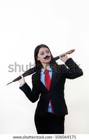 young woman dressed up in a man's suit and tie wearing a fake mustache holding a umbrella