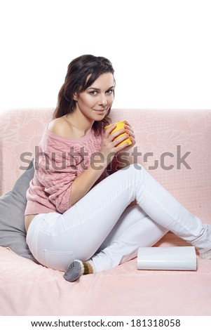 young woman drink coffee and reading a book - stock photo