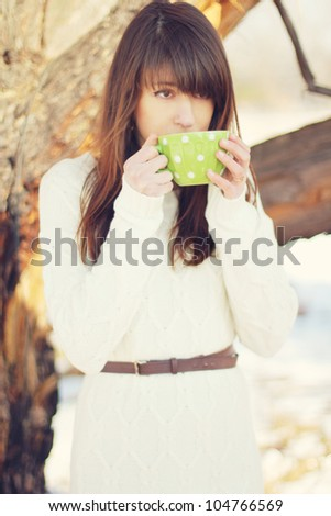 young woman drink tea