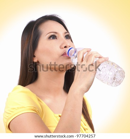 young woman drinking a fresh water