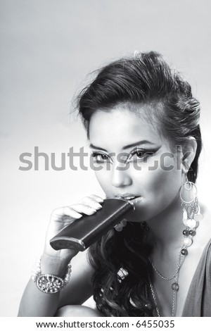 Young woman drinking alcohol from hip-flask (BW)