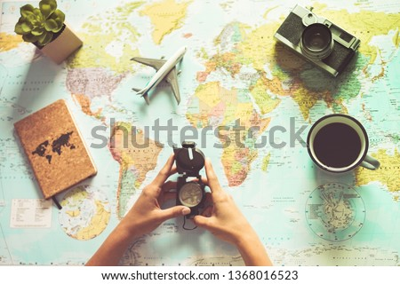 Young woman drinking coffee and planning world tour with vintage travel map - Backpacker girl looking for a new countries to explore - Journey trends, globetrotter and holiday concept - Focus on mug