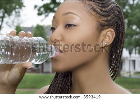 Young Woman Drinking from a Bottle of Water