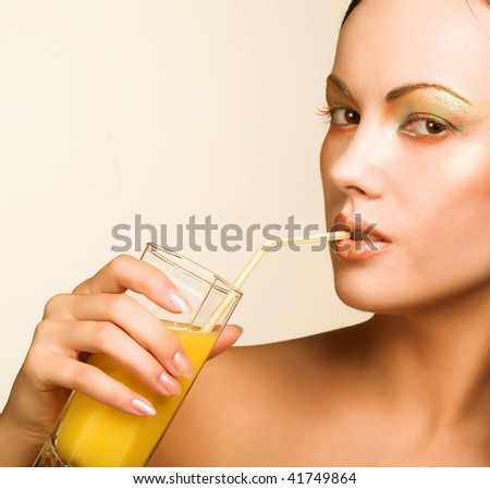 young woman drinking orange juice close up