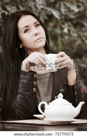 [Image: stock-photo-young-woman-drinking-tea-at-...779073.jpg]