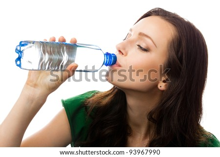 Young woman drinking water from bottle, isolated over white background - stock photo