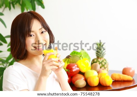 young Woman drinks juice
