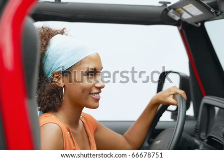 Young woman driving a Jeep