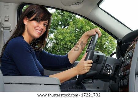 Young Woman Driving Her Sports Utility Truck