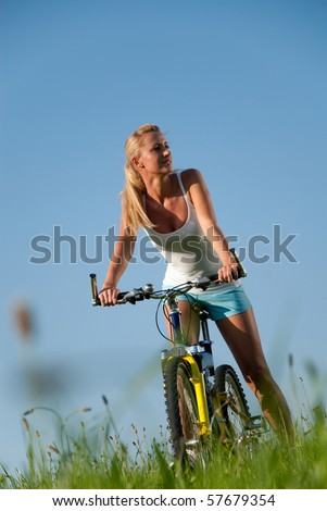 young woman driving on a mountain bike in her free time