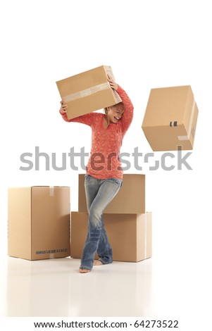 Young woman dropping cardboard boxes