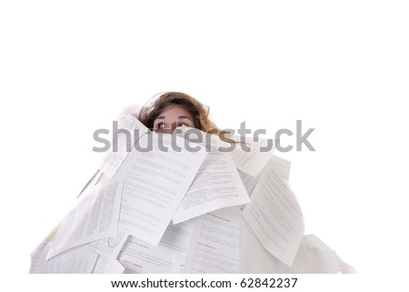 young woman drowning in a mountain of papers