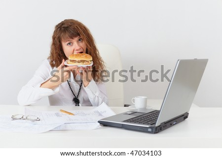 Young woman eagerly have a sandwich