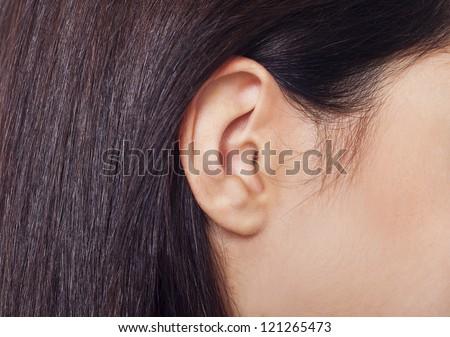 Young woman ear closeup