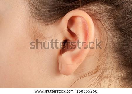 Young woman ear closeup.