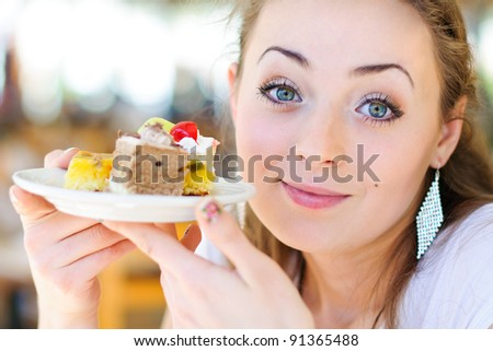 Young woman eat dessert