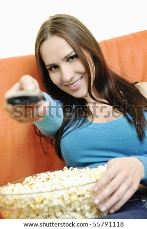 young woman eat popcorn, watching movies and eat popcor isolated on white