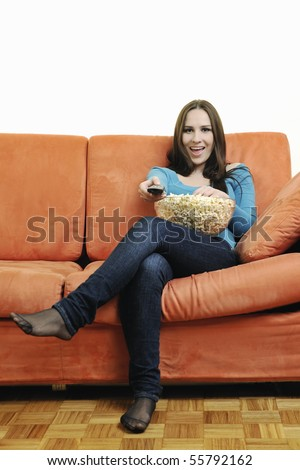 young woman eat popcorn, watching movies and eat popcorn isolated on white