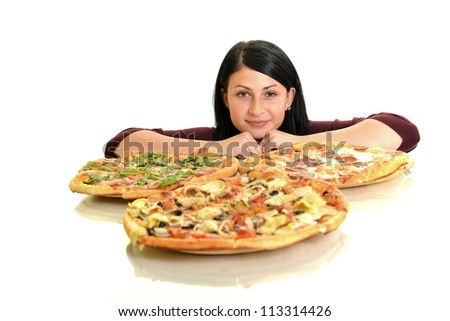 young woman eating a piece of pizza against a green background