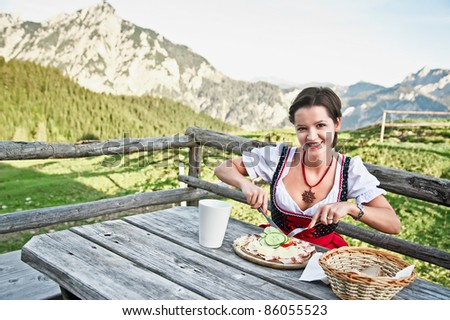 Young Woman eating Brettljause