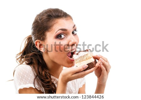 Young woman eating delicious piece of cake