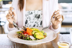 Young woman eating healthy salad at restuarant, Healthy lifestyle, diet concept