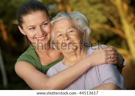 Young woman embracing her grandmother.