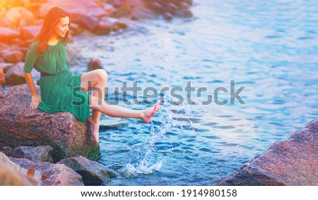 Young woman enjoy happy life at morning sunrise. Girl feel well in lake water on free beach. Summer nature beauty, people health, good sea travel relax, sun energy peace view, person live joy concept. 商業照片 ©