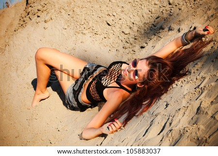 young  woman enjoy in sunset in sand summer day