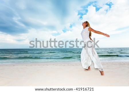 Young woman enjoy sea breeze on the beach