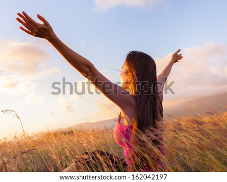 Young woman enjoy sunshine in wheat field