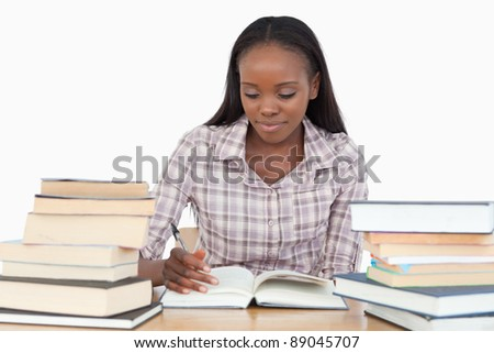 Young woman enjoying a novel against a white background