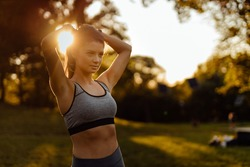 Young woman enjoying afternoon, workout time.