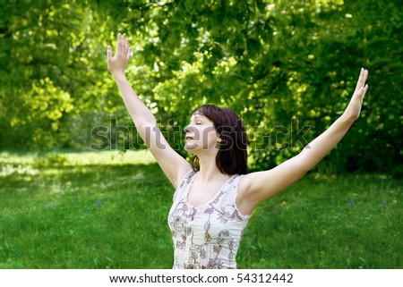 Young woman enjoying fresh air in the park