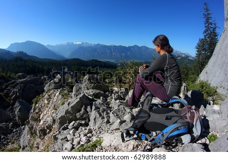 Young woman enjoying mountain panorama in the Alps