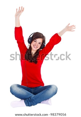 Young woman enjoying music while sitting on the floor