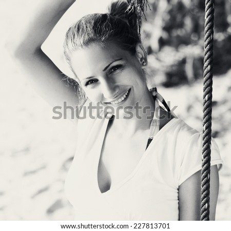 Young woman enjoying summer breeze at the beach. Black and white.