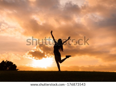 Young woman enjoying sunset in Hawaii. Freedom concept.
