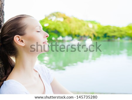 Young woman enjoying the sun in the park