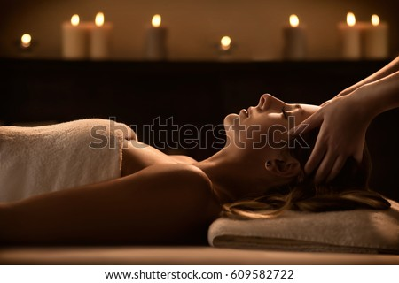 Young woman enjoys massage in a luxury spa resort