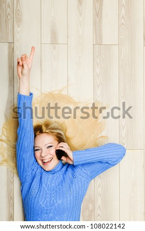 Young woman excited while chatting - stock photo