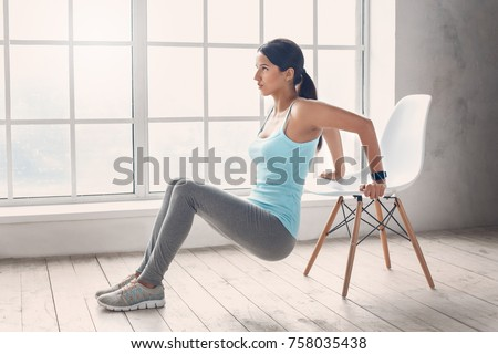 Young woman exercise at home healthy lifestyle #758035438