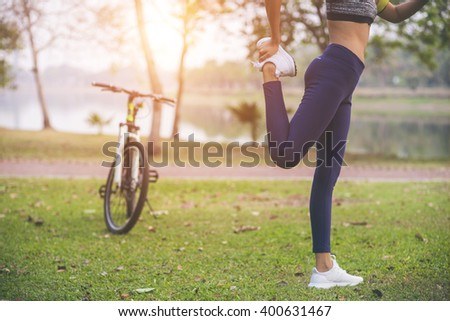 young woman, exercise in gardent background