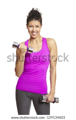Young woman exercising in sports outfit holding dumbbells on white background