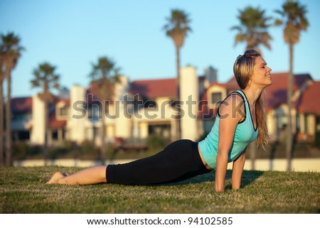 Young woman exercising in the park