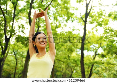 young woman exercising on the park