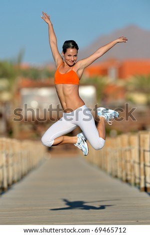 young woman exercising outdoor in summer
