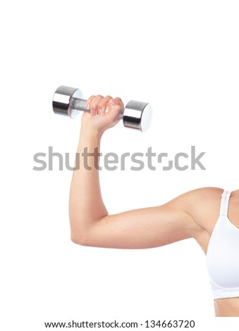 Young woman exercising with weight. Closeup of an arm with a dumbbell isolated on white background. - stock photo
