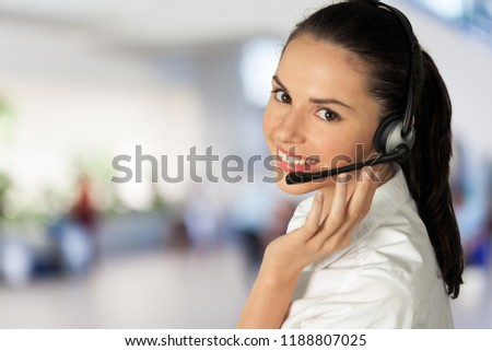 Young woman face with headphones, call center