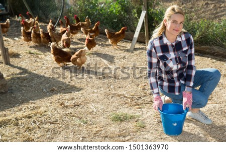 Young woman farmer caring for poultry  #1501363970